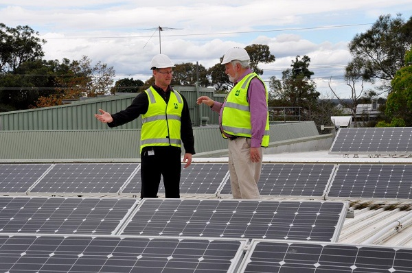 WSROC President Cr Barry Calvert inspecting existing solar panels on the Hawkesbury City Council administration precinct.