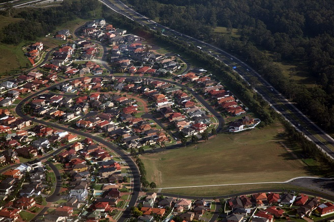 Aerial shot of housing estate next to a motorway.