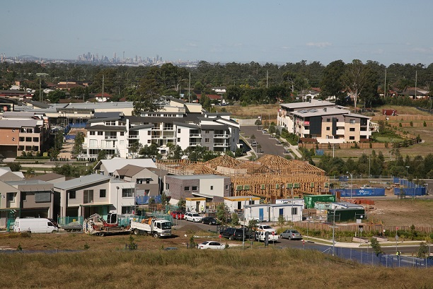 Greenfield housing estate in Western Sydney. Sydney in the background.