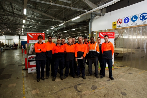 Workers at Mission Australia's Soft Landing mattress recycling plant in Smithfield.