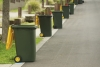 Recycling bins presented on kerb.