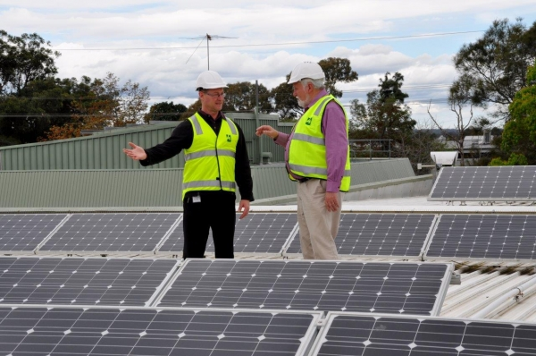 WSROC President Councillor Barry Calvert inspecting solar panels on Hawkesbury City Council's administration building.