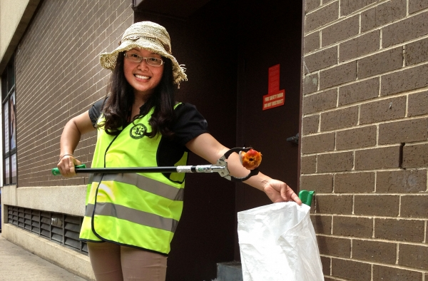 Council officer picking up litter during Clean-up Australia Day, Parramatta City Council