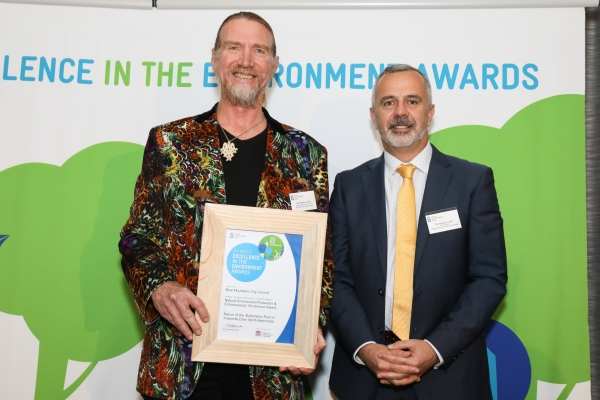 Blue Mountains City Council officer accepting award for winning project Return of the Bottomless Pool in Yosemite Creek, North Katoomba.