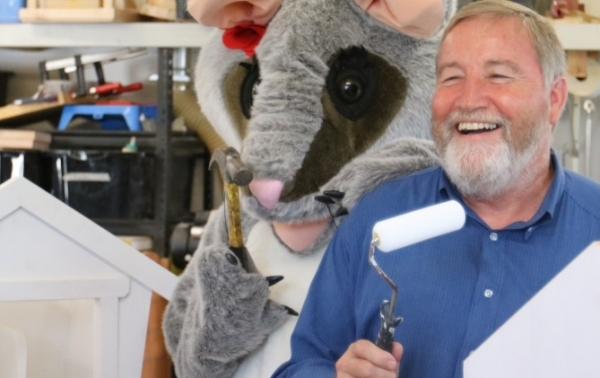 Cumberland Mayor Greg Cummings with Poppy the Possum and new community reading boxes