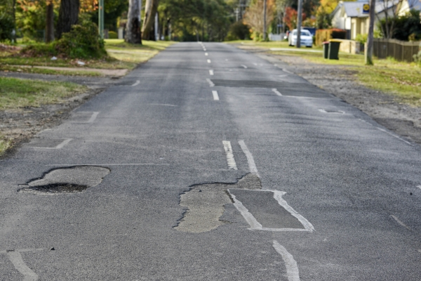 Poorly maintained local road.