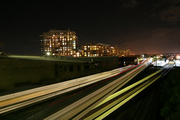 Car travelling along a motorway at night.