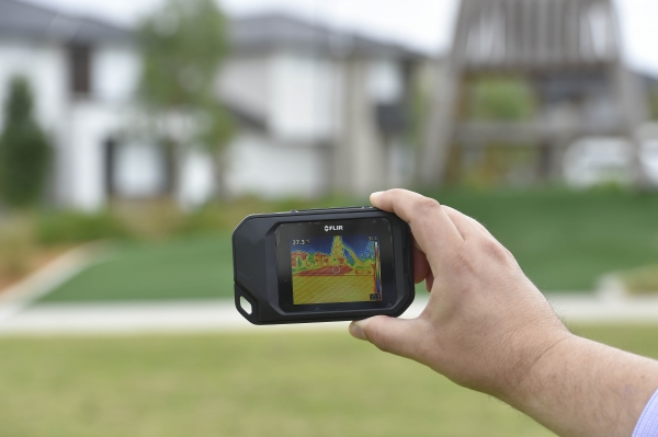 Heat camera picking up surface temperature of play equipment in a new development.
